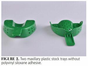 FIGURE 2. Two maxillary plastic stock trays without polyvinyl siloxane adhesive.